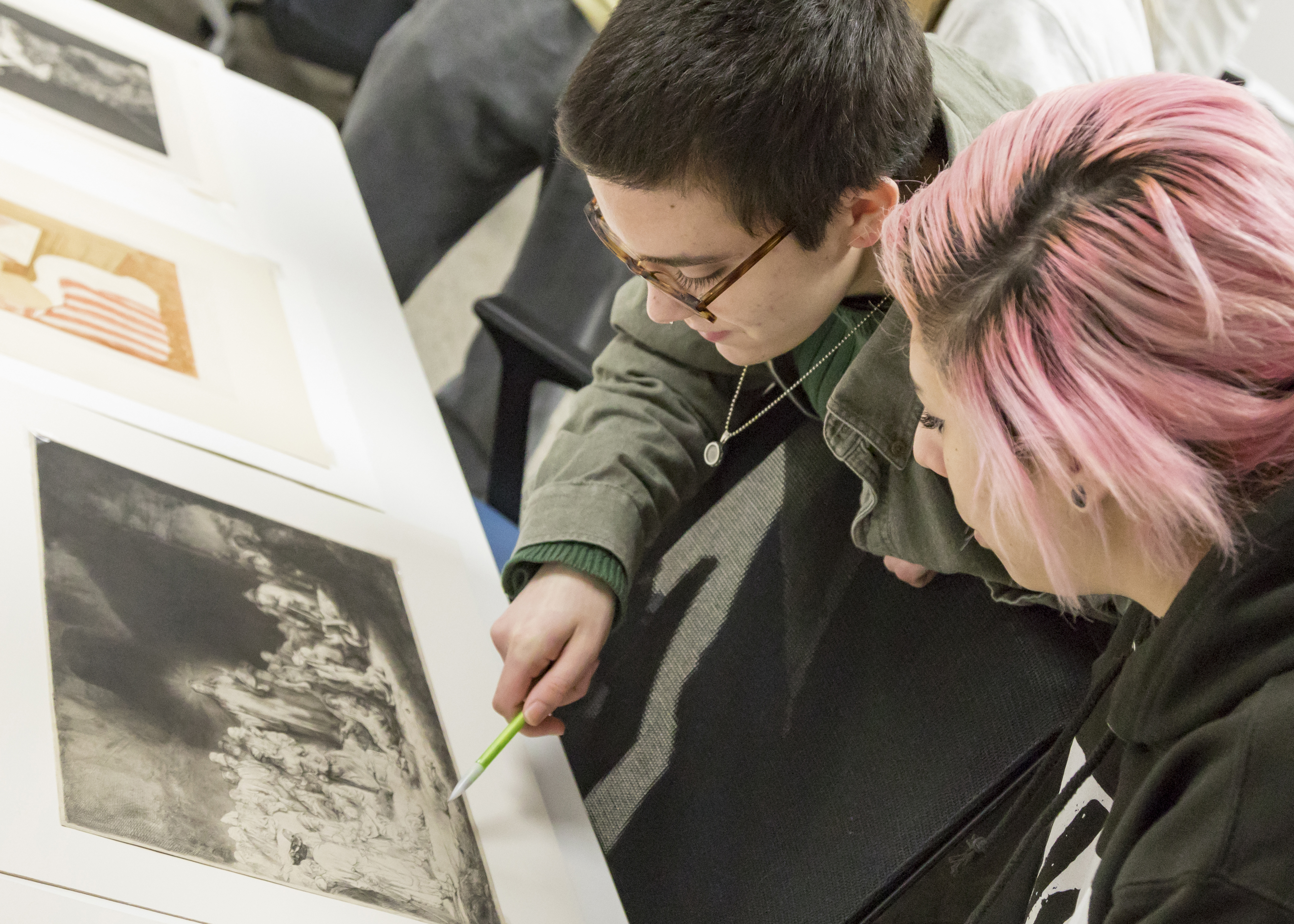 Image for Students examine works from the College's archives as part of an interdisciplinary course with faculty from Muhlenberg's History Department. Our curriculum approaches art with an interdisciplinary, interactive and international lens.