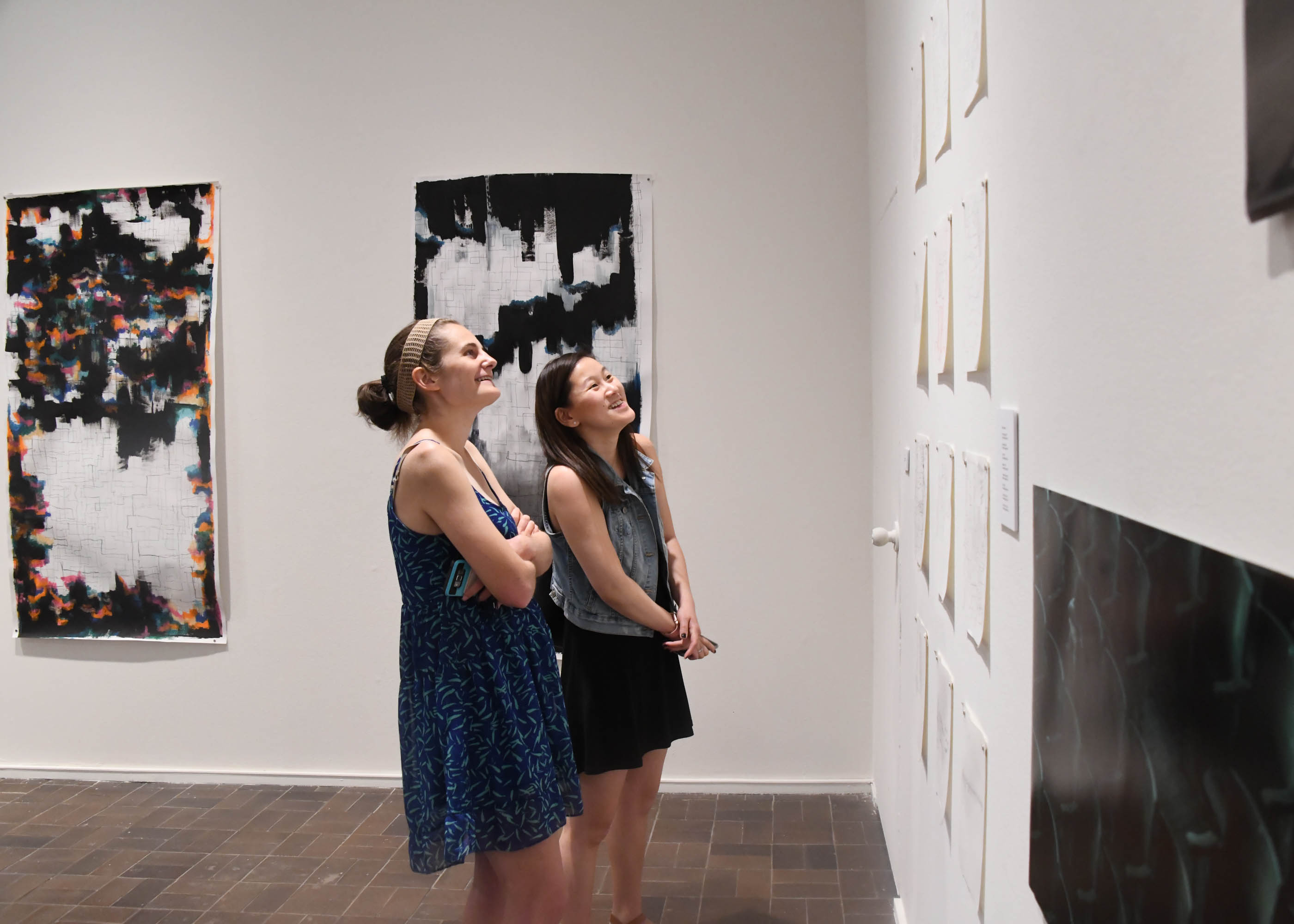 Image for Muhlenberg students view an exhibition by senior studio art majors. In addition to shows at the College's Martin Art Gallery, students have the opportunity to exhibit their work at annual exhibition at a studio in Brooklyn, New York.